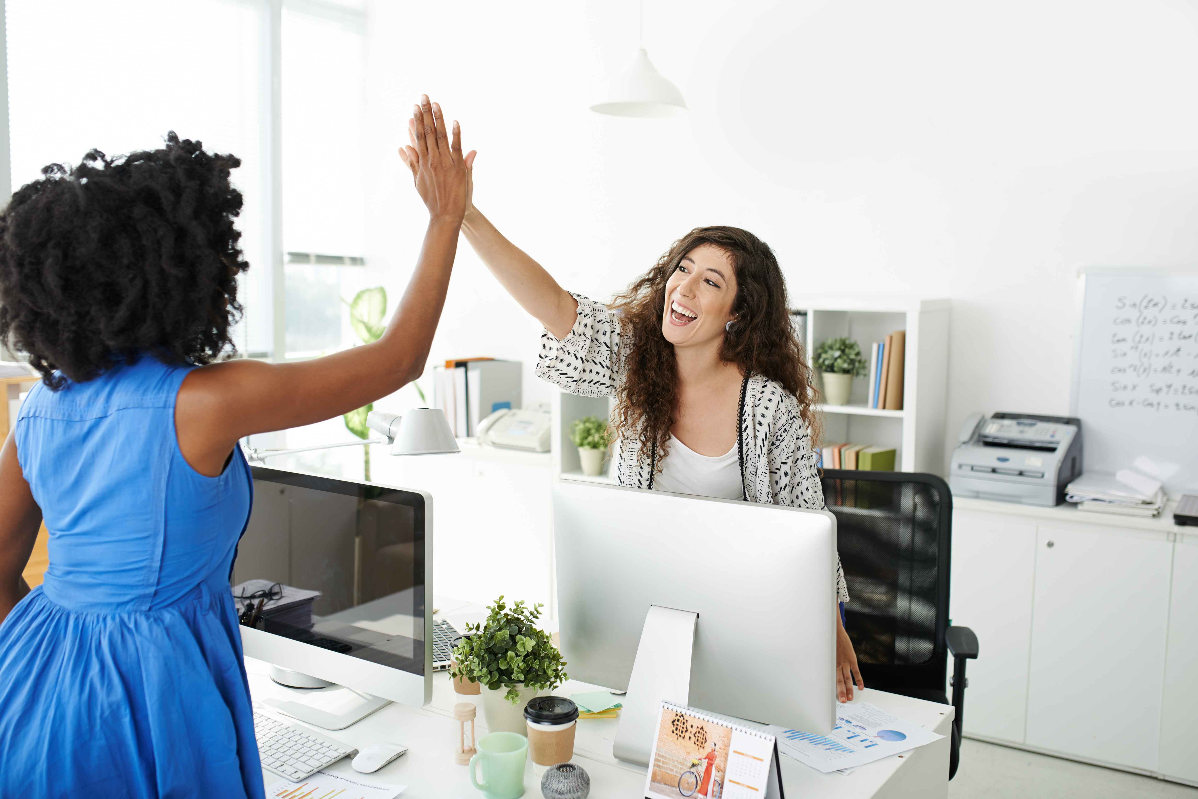 Pretty business lady giving high five to her colleague